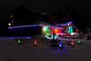 Walt Hester | Trail Gazette<br /> A colorful home lights the evening near the corner of Bighorn and Spruce Drives.