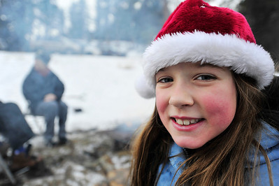 Walt Hester | Trail Gazette With rosie cheeks and the familiar fuzzy red and white hat, Rylee Crouch, 8, of Thornton is ready for Christmas while resting at the ice skating pond at the YMCA of the Rockies on Wednesday.