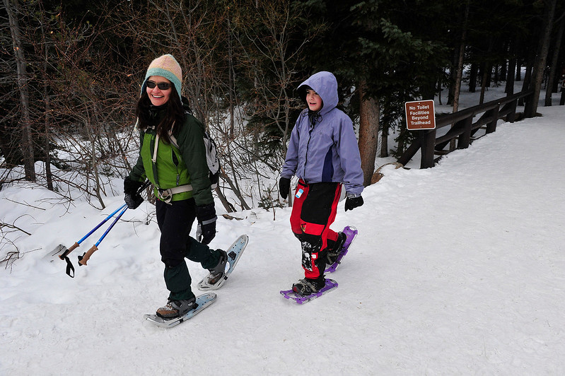 Walt Hester | Trail Gazette<br /> Vicky Santibanez, left, and Alina Biernacki, 11, of Lafayette, Colo., return to the Bear Lake Trail Head after a snowshoe hike on Wednesday. The Bear Lake area offers a wide variety of snowshoeing terrain, with backed trails and relatively level trails around Bear Lake, o much steeper, deeper snow off of the winter trail between Bear and Nymph lakes.