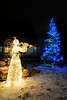 Walt Hester | Trail Gazette<br /> An angel performs near a blue tree along Bighorn Drive.