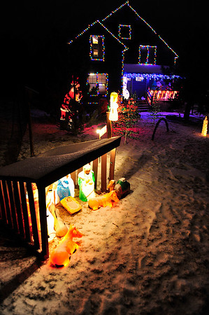 Walt Hester | Trail Gazette<br /> This home on Stanley Circle Drive is big and colorful and visible from the Estes Park Medical Center. More than lights, the display blinks and fades and has it's own radio station.