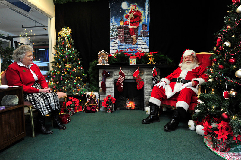 Walt Hester | Trail Gazette<br /> Santa and Mrs. Clause await visitors at the Old Church Shoppes on Sunday. With a week to go, the jolly guy seems relaxed.