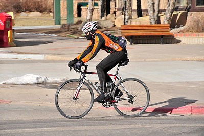 Walt Hester | Trail Gazette A well-insulated cyclist cruises through downtown Estes Park on Sunday. While still a little chilly, weekend temperatures crowded 50 degrees.