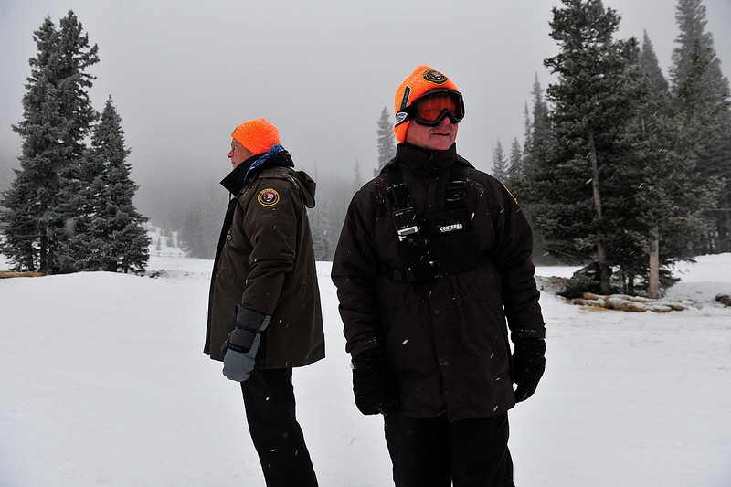 Walt Hester | Trail Gazette<br /> Volunteer rangers Don Lickfett, left, and Joe Phillips keep track of sledders in the snow and drifting clowds of freezing fog at Hidden Valley on Monday. The rangers watch the slope and keep the warming house open until 4 pm each day.
