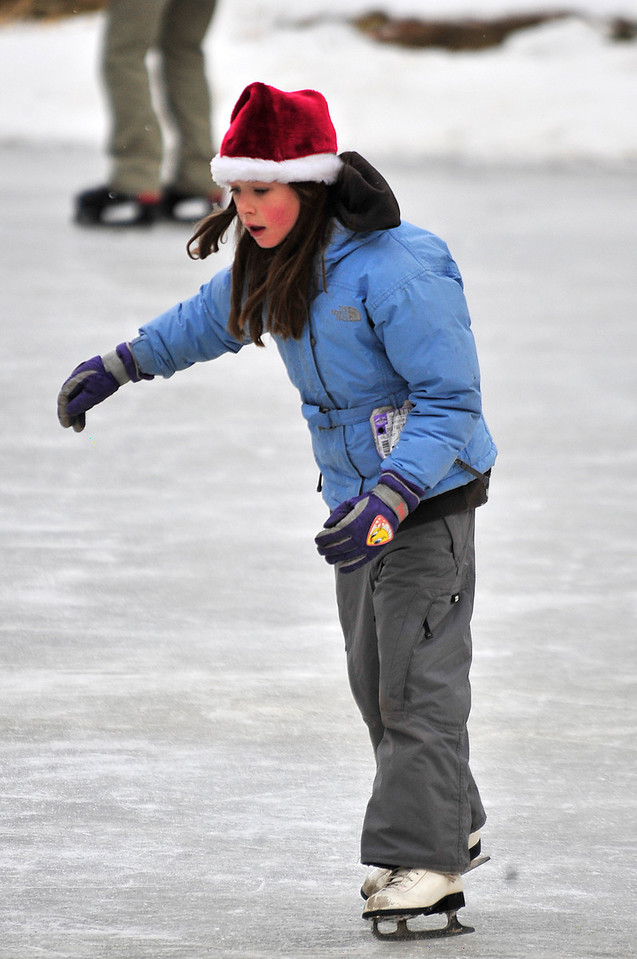 Walt Hester | Trail Gazette<br /> Rylee Crouch, 8, of Thornton, glides across the ice at Dorsey Lake at the YMCA of the Rockies. There are plenty of opportunities for families to enjoy snow together around Estes Park.