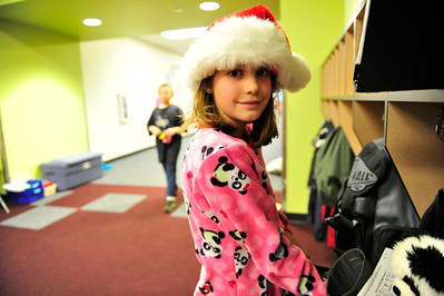 Walt Hester | Trail Gazette Emma Patterson sports a Santa hat and pink pajamas on Polar Express Day at the Estes Park Elementary School on Friday. Students enjoy the movie and hot cocoa on the last day of classes before winter break.