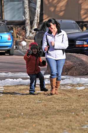 Walt Hester | Trail Gazette<br /> A child tosses a snowball at his mother in Bond Park on Sunday. Some snow is expected on Thursday, but the Christmas weekend should be sunny.