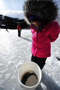 Walt Hester | Trail Gazette Rachel Garza, 7, of Frisco Texas watches the trout that she and her brother, fishing behind her, Caleb, 11, pulled from the pond at Trout Haven on Wednesday. Ice fishing seems to be gaining popularity around Estes Park.