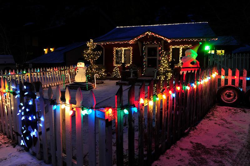Walt Hester   Trail Gazette<br /> A little house sports a big display along East Riverside Drive.