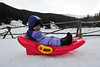 Walt Hester | Trail Gazette<br /> Three-year-old Audry Schwartz shuts her eyes tight against the wind-blown snow at the Hidden Valley Snowplay Area on Wednesday. High winds whipped snow and rattled windows around Estes Park for most of the week.
