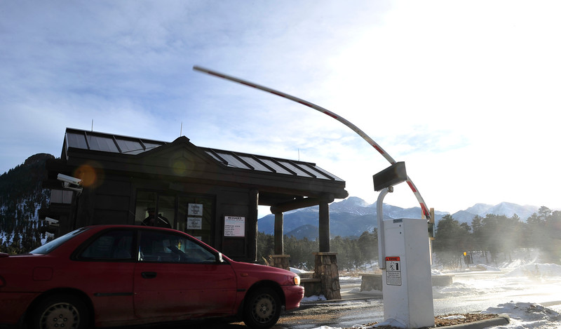 Walt Hester | Trail Gazette<br /> High winds wrap the gate arm round its base at the Beaver Meadows Entrence of the park on Wednesday. The arm is flexable, said a ranger, but the gate does not work well in the high winds.