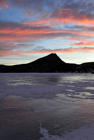 Walt Hester | Trail Gazette<br /> Wednesday's sunrise reflects off of ice and snow on Lake Estes. Very cold mornings will give way to mild days for the weekend.