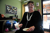 Walt Hester | Trail Gazette<br /> Jane Crawford enjoys snacks after receiving gifts at the Prospect Park Living Center on Thursday. PPLC has enjoyed the Christmas event for several years.
