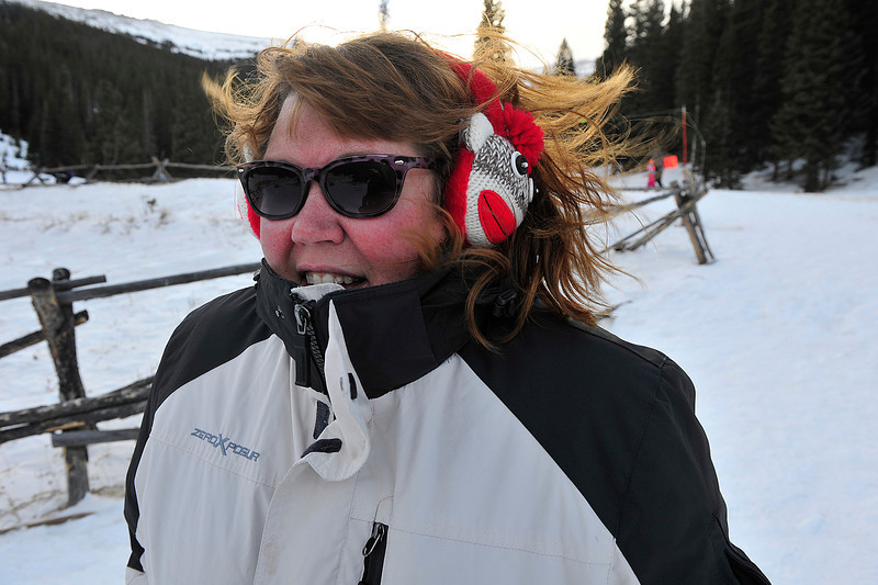 Walt Hester | Trail Gazette<br /> Jessica Trovik of Colorado Springs wears sock monkey earmuffs to protect against Wednesday's wind in Hidden Valley. The biting wind was not enough to keep visitors from enjoying the snowplay in Rocky Mountain National Park.