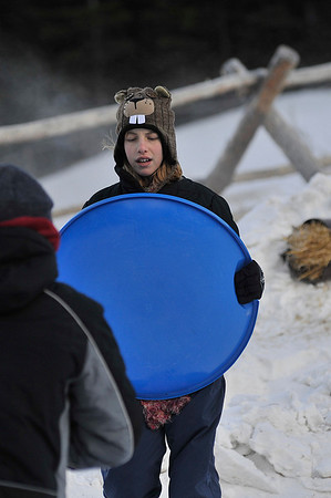 Walt Hester | Trail Gazette<br /> Olivia Trovik, 13, of Colorado Springs sports amusing headware while sledding in Rocky Mountain National Park on Wednesday. Hidden Valley Snowplay Area spends most of the winter days in shadow and a good, and even funny, hat is often necessary.