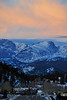 Walt Hester | Trail Gazette<br /> Rising sun colors clouds above the Continental Divide and Estes Park on Wednesday morning. Estes Park should expect mild temperatures but breezy for the weekend.