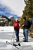Walt Hester | Trail Gazette<br /> Bobbi, left, and Tony Kerridge of Boulder fish out a camera for a photo at Nymph Lake on Wednesday. Whil we have been dry for better than a week, snow may return this weekend.