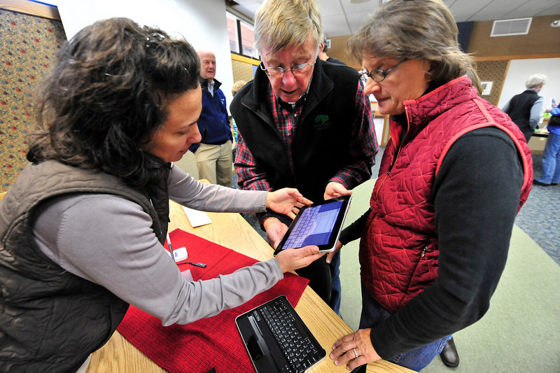 Walt Hester | Trail Gazette<br /> Estes Valley Library director Claudine Perrault shows the Apple iPad to Ed and Marlene Hayek at the library's Technology Petting Zoo on Wednesday. The event, one of several plnned for the year, introduces people to the new ways to enjoy literature.