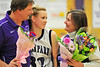 Walt Hester | Trail Gazette<br /> Kyra Stark is squeezed by her parents at Senior Night before Friday's last regular season home game. Stark was one of four Ladycats to score more than 10 points and helped lead the team to its eighth straight win.