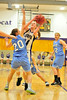Walt Hester | Trail Gazette<br /> Kimmy Hansen menuvers around and through Platte Valley defenders during Friday's route of the Broncos. Hansen scored 20 points on Friday, then turned round to score another 14 against the Brush Beetdiggers on Saturday.