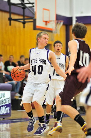 Walt Hester   Trail Gazette<br /> Taylor Marshall leads the 'Cats up the court in the fourth quarter. Marshall has enjoyed a good amount of playing time over the season, and will likely lead in the seasons to come.