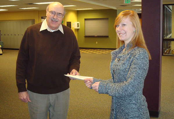 Couresy Photo<br /> Estes Park High School Student Council President Caroline Miller presents a check for $300 to Crossroads Ministries. The money was raised from ticket sales to the school's annual MORP dance.