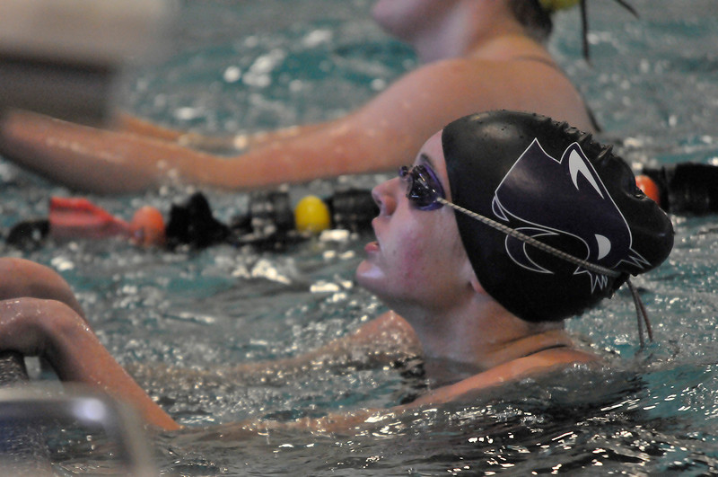 Walt Hester | Trail Gazette<br /> Kate Hewson checks her time, which was :25.41 in the championship heat of the 50 yard freestyle at the Girls 4A State Swim Meet on Saturday. Hewson finished 6th in the state, the highst finish by a Ladycat swimmer this season.