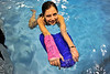 Walt Hester | Trail Gazette<br /> Watercats swimmer Abby Lemirande floats with her bright pink cast. The cushioning on the inside is a synthetic fabric and the cast itself is fiberglass and only requires a cool hair dryer after swimming.
