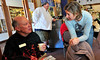 "Walt Hester | Trail Gazette<br /> Estes Park mayor Bill Pinkham enjoys a cup of coffee on Thursdsy with Kind Coffee's Amy Hamrick at the unveiling of the ""Best Coffee to enjoy with Pie"". The tasting was held during the Winter Festival in January."