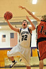Walt Hester | Trail Gazette<br /> Senior and team leader Zach Eitzen drives against Mead on Tuesday. Eitzen was able to finish his home season with his third double-doulbe of the season having scored 12 points and collected 10 rebounds.