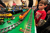 Walt Hester | Trail Gazette<br /> Cooper Smith of Estes Park watches the Leggo train race around the track at the annual Rails in the Rockies at the Estes Park Conference Center on Sunday. The display used more than 100,000 leggo pieces to complete.