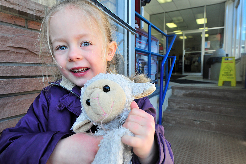 Walt Hester | Trail Gazette<br /> A friendly little Estes Park resident and her little lamb hold the door at the post office on Tuesday. Livestock is not generally allowed in the post office, but exeptions are occasionally made.