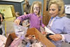 Walt Hester | Trail Gazette<br /> Annalise Anderson, 5, of Estes Park fishes out a prize from the grab bag box with the help of volunteer, Barbara Jampolis. Imagine This could not happen without the help of the volunteers.