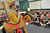 "Walt Hester | Trail Gazette<br /> ""Buckin' Barbie"" Ayres entertains the first grade at Estes Park Elementary School on Friday with tales of growing up in Big Sky country. Ayres and her sisters grew up on a ranch in Montana."