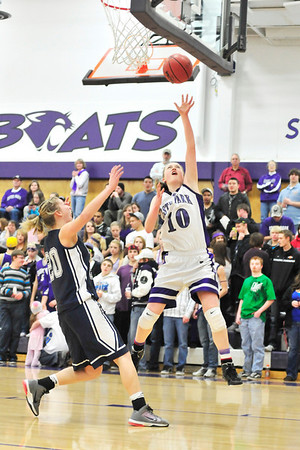 Walt Hester | Trail Gazette<br /> Senior Kimmy Hansen lead all scorers with 22 points in the Tuesday tournament tilt against University. Hansen actually scored only two fewer points than all of the Bulldogs combined.