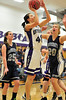 Walt Hester | Trail Gazette<br /> Chelsea Weitzel gets around University defenders Becky Reeves (25) and Tori Fisher (20) during the first quarter of the Estes Park gameagainst the Bulldogs. While Weitzel scored only three points, she managed seven rebounds to lead the Ladycats over University, 50-24.