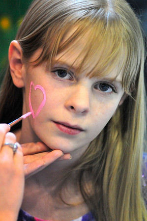 Walt Hester | Trail Gazette<br /> Mariah Garrison, 12, of Thornton gets a heart painted on her cheek. In some cases at Imagine This, the children were the canvas.
