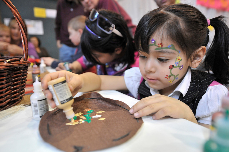 Walt Hester | Trail Gazette<br /> Daphne Rangle, 5, uses some fabric paint to decorate a mountain man bag. Some of the creative opportunities also tought history as well as culture.