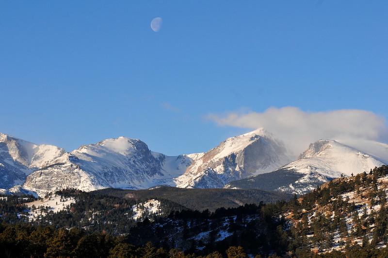 Walt Hester   Trail Gazette<br /> The moon slowly drifts across a mostly tranquil sky toward the Continental Divide on Tuesday. Skies are expected to change as the weekend approaches, with th posibility of snow in the forecast.