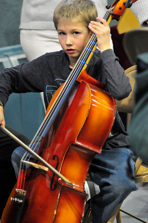 Walt Hester | Trail Gazette<br /> Benjamin Anderson, 7, of Estes Park tries his hand at the cello. Many musical opportunities were available to the young visitors.