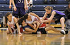 Walt Hester | Trail Gazette<br /> Julia Lawrence, right, and Chelsea Weitzel wrestle with two of Eaton's Cheney sisters for a ball during the first half of Friday nights Patriot League District Championship. The Ladycats' defense forced 20 turnovers, resulting in lots of points for Estes Park.