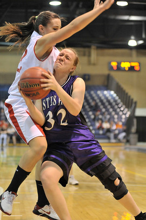 Walt Hester | Trail Gazette<br /> Senior Kyra Stark collides with one of Eaton's Cheney sisters on Friday. Stark called for the press when she saw the Cheney's out, resulting in Eaton turnovers and Estes Park points during the district championship game.