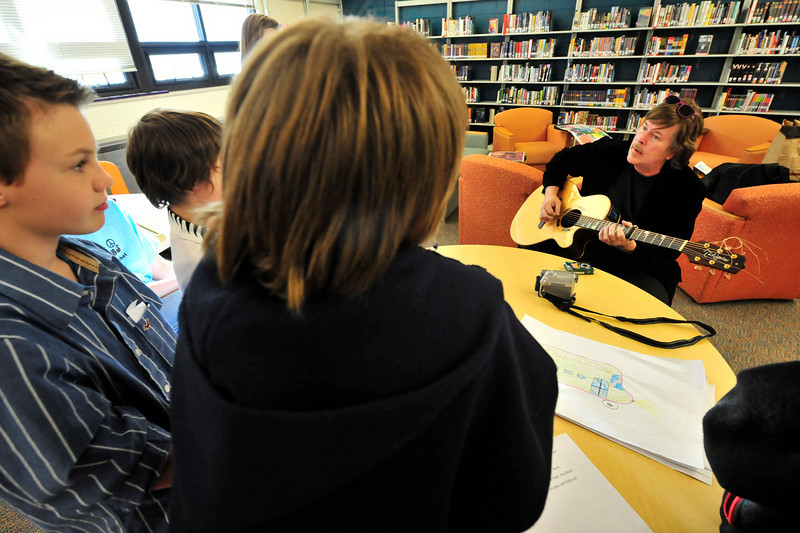 "Walt Hester | Trail Gazette<br /> Firefall front man Jock Bartley plays for the middle school's Shuttle Bugs at the school's library on Wednesday. Bartley has agreed to let the group, concerned with promoting more shuttle bus usage in the tow, to use his tune ""Walk More Softly"" to help promote their cause."