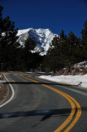Walt Hester | Trail Gazette<br /> The road on the north side of Deer Ridge Junction seems to wind toward a snow-covered Mount Ypsilon on Tuesday. Snow may reappear for the weekend.