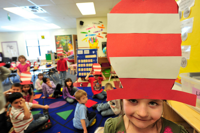 Walt Hester | Trail Gazette<br /> Emma Coleman, 6, sports the hat made famous by Theodor Seuss Geisel, better known as Dr. Seuss. Tuesday was Dr. Seuss Day at the Estes Park Elementary School and the author's 107th birthday.