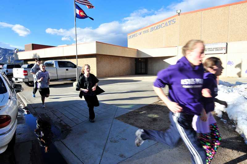 Walt Hester | Trail Gazette<br /> Runners from the Estes Park High School and Middle School track team get a jump on spring on Wednesday with an afternoon run. The high school track season begins Saturday, March 12 at Fort Morgan.