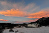 Walt Hester | Trail Gazette<br /> Orange clouds bid farewell to Monday as the light fades over Estes Park.