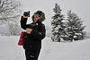 Walt Hester | Trail Gazette<br /> Ilona Spangler of Estes Park makes a video of the falling snow along Bond Park on Friday. Estes Park received around 6-8 inches of snow from this latest storm