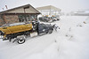 Walt Hester | Trail Gazette<br /> A town works sand truck prepares to make rounds downtown during Friday's snow storm.