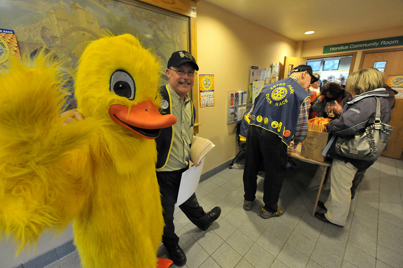 Walt Hester | Trail Gazette<br /> Quiltin T. Canvasback and this year's Big Duck, Scott Thompson, help kick off Duck Race Season at the Estes Valley Library on Thursday. The Duck Race distriuted adoption forms to local organizations.